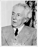 ******** Frank Lloyd Wright in a grey suit, seated, 1945