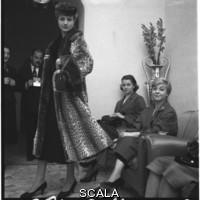 ******** Giulietta Masina attends a parade of furs
