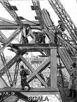 ******** Eiffel tower being constructed. 1889 illustration of workers constructing the Eiffel Tower in Paris, France, in February 1888. The Eiffel Tower was erected in 1889 as the entrance to the 1889 World's Fair, and was named after its designer Gustave Eiffel.