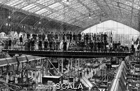 ******** 1889 Exposition Universelle. 1889 illustration of visitors standing on a moving bridge in the machines hall of the 1889 Exposition Universelle in Paris, France. The 1889 Exposition Universelle was a world's fair held during the year of the 100th anniversary of the storming of the Bastille, a symbolic event of the French Revolution. The main symbol of the 1889 event was the newly-completed Eiffel Tower.