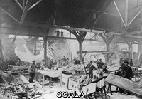 ******** Statue of Liberty construction. Workmen constructing the Statue of Liberty in Parisian warehouse workshop of the French sculptor Frederic Auguste Bartholdi (1834-1904). This is the first model, with parts of the left hand and a quarter-size head visible. This image was obtained in around the winter of 1882. The photographer was Albert Fernique (c.1841-1898). This statue, which was originally known as Liberty Enlightening the World, took the form of a woman holding a torch and a book. The final figure was 46.4 metres tall, made from copper plates riveted to an iron framework. The design by Frederic Bartholdi was executed by Gustav Eiffel. The statue was given by France to the USA to commemorate the 100th anniversary of the 1776 American Declaration of Independence.