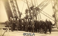 ******** Eiffel Tower architects. Group of architects visiting the Eiffel Tower in Paris, France, during its construction. The group are from the 'Societe Centrale des Architects' (Central Society of Architects). At the time, the first level of the tower had been completed and the second level was being built. This wrought iron tower, 324 metres tall, was built from 1887 as the entrance arch for the Universal Exposition (World Fair) of 1889. At the time, it was the tallest structure in the world. The tower is named after its designer the French engineer Gustave Eiffel. This albumen silver print is from a photograph taken on 16 June 1888 by Louis-Emile Durandelle (1839-1917).