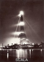 ******** Eiffel Tower at night during the Paris Exposition. View of the Eiffel Tower, Paris, France, lit up at night during the Paris Exposition of 1889. The beacon at the top of the tower is electric, but at this time all the other lamps were gas. Designed by the French civil engineer Gustave Eiffel (1832-1923), the Eiffel Tower was built for the International Exhibition staged in Paris in 1889 to commemorate the centenary of the French Revolution. Constructed from iron, it was the tallest building in the world until 1930.
