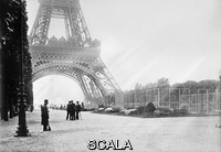 ******** A guard on duty next to a wireless station (right) at the base of the Eiffel Tower, Paris, France, during World War I. The underground station was used by the French Military from 1909. Antennas on the Eiffel Tower were used to transmit signals up to 6000 kilometres, far enough to reach the USA and transatlantic ships. It was also used to intercept German transmissions, providing intelligence to the allies. Designed by the French civil engineer Gustave Eiffel (1832-1923), the Eiffel Tower was built for the International Exhibition staged in Paris in 1889 to commemorate the centenary of the French Revolution. Constructed from iron, it was the tallest building in the world until 1930. Photographed circa 1914-1915.