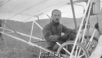 ******** Alberto Santos-Dumont (1873-1932), Brazilian aviation pioneer, sitting in 'Demoiselle', his famed light aircraft. The son of a rich plantation owner, Santos-Dumont became interested in flight while studying engineering in Paris, France. After piloting balloons, he built his first powered airship in 1898. His airship flight exploits caught the public imagination. In October 1901, Santos-Dumont received a prize for being the first person to fly around the Eiffel Tower. He built an aeroplane in 1906, the 14 bis and made the first sustained free flight in Europe on 23 October 1906 in Bagatelle Park, Paris, France.
