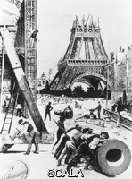 ******** Eiffel Tower. Illustration of the Eiffel Tower during construction in 1888. The open-lattice tower (centre) was designed by Alexandre Gustave Eiffel (1832-1923) and erected for the 1889 Paris Exhibition. It cost #260, 000, used 15, 000 wrought-iron sections and 2, 500, 000 rivets and, including its installations, originally weighed 9700 tonnes. Without its modern broadcasting antenna, it stands 312 metres high, and was the world's tallest man-made structure until 1930. During the early 20th century, the tower held laboratories for the study of astonomy, biology, meteorology, atmospheric pollution, as well as radio and television transmitters.