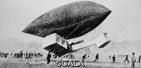 ******** Testing of early aeroplane. Historical image of the testing of Albert Santos-Dumont's aeroplane No. 14 by suspending it from an airship. This aeroplane became the first to make a powered flight in Europe. The flight took place on 13 September 1906 and consisted of a series of short hops, the longest being 220 metres. Santos-Dumont had previously claimed a prize for being the first person to fly around the Eiffel Tower in 1901.
