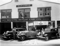 ******** 1932 Ford V8 in front of a car showroom, (c1932?).